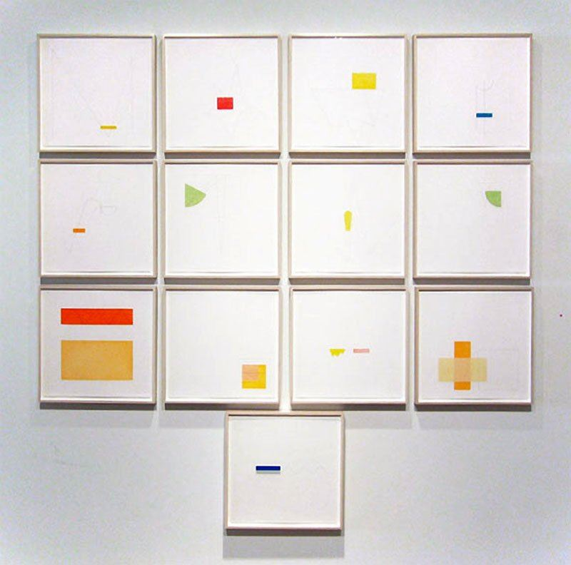 thirteen prints framed in a grid with various abstract designs by Richard Tuttle